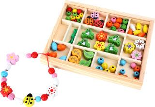 Perles à enfiler dans la boîte
